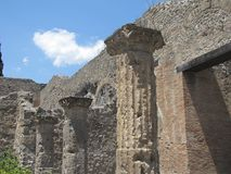Sweltering heat rises over the ruins of Pompeii in Italy. Volcanic ash, broken buildings, shattered columns and stone streets are all that`s left in the ruins royalty free stock photo
