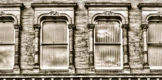 Swept Head Decorative Sash Windows HDR. Horizontal black and white sepia tone photography Royalty Free Stock Images