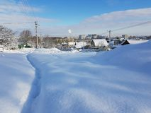 Swept snowy road and city royalty free stock photography