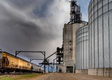 Swift Current, SK/Canada- 10 May, 2019:  Semi unloading with stormy skies at Paterson Grain Terminal in Swift Current, SK, Canada royalty free stock photo