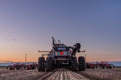 Swift Current, SK/Canada- May 10, 2019: Tractor and Bourgault air drill seeding equipment in the field stock image