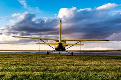 Swift Current, SK/Canada- May 10, 2019: Yellow Cessna Plane in stormy skies stock image