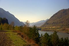 The swift Katun River carries its turquoise waters along the foot of the Altai Mountains. Gorny Altai, Siberia, Russia. Landscape. The swift Katun River carries royalty free stock image