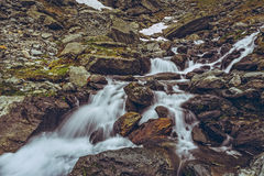 Swift mountain stream rapids Stock Photos