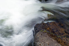 Swift waters in flowing Yellowstone River. Stock Images