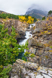 Swiftcurrent Falls. Vertical Compositions of Swiftcurrent Falls, Many Glaciers Area Of Glacier National Pakr, Montana Stock Photo