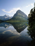 SWIFTCURRENT  LAKE, GLACIER NP. Reflection  of surrounding hills in Swiftcurrent Lake Royalty Free Stock Photography