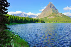 Swiftcurrent lake in high alpine landscape on the Grinnell Glacier trail, Glacier national park, Montana Stock Photos