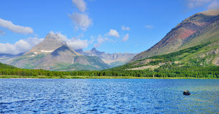 Swiftcurrent lake in high alpine landscape on the Grinnell Glacier trail, Glacier national park, Montana Stock Images