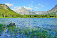 Swiftcurrent lake in high alpine landscape on the Grinnell Glacier trail, Glacier national park, Montana Stock Image