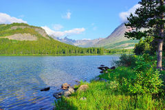 Swiftcurrent lake in high alpine landscape on the Grinnell Glacier trail, Glacier national park, Montana Stock Photo