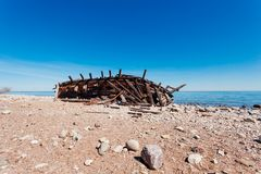 Swiks at the seashore of Öland in Sweden. Wooden ship wreck Swiks at the seashore of Öland in Sweden with horizon in the background Stock Image