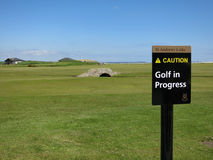 Swilken Bridge and a `Caution, Golf in Progress`-sign Stock Photos
