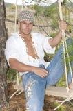 swim усаживания человека джинсыов пущи Стоковая Фотография