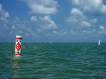 Swim area buoy against expanse of water. A swim area marker bobs in Lake Michigan on a Summer day stock photos