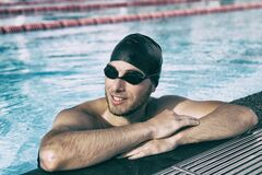 Free Swim Athlete Man Wearing Sport Glasses And Cap In Indoor Swimming Pool Royalty Free Stock Image - 196091316