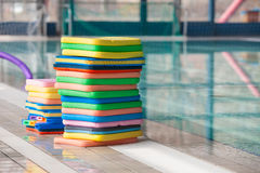Swim boards. Stack of the colourful swim boards in the swimming pool stock images