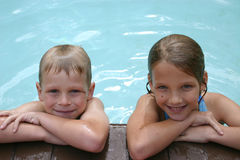 Swim Buddies. Boy & Girl siblings together in pool Stock Images