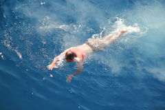 Swim in clear water Royalty Free Stock Photos