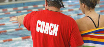 Swim Coach With Athlete Stock Photo