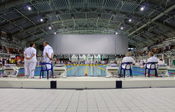Swim competition pool and officials Stock Photos