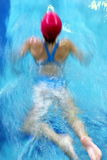 Swim crawl stroke. A swim teen girl swimmer in the competition Stock Image
