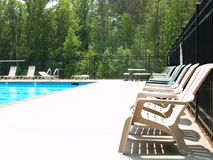 Swim Deck. Row of adirondack chairs on a pool deck Stock Photography