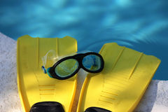Swim Fins. And mask pool side royalty free stock image