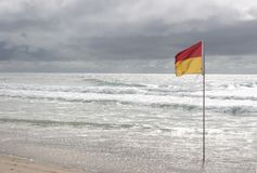 Swim Flag at Surfers Paradise beach Stock Images