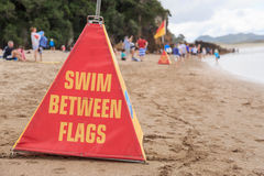 Swim between flags warning cone Royalty Free Stock Image