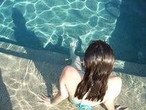 Swim Girl. Burnett girl at pool side Royalty Free Stock Photo