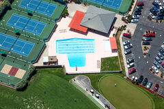 Swim, Golf, Tennis. Multiple recreation venue of swimming, golfing or tennis viewed from overhead Royalty Free Stock Image