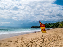 Swim here. Safety warning signs for tourists.  Blackground with Stock Image