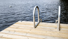 Swim Ladder. A swim ladder to help climb out of a refreshing summer lake Royalty Free Stock Photo