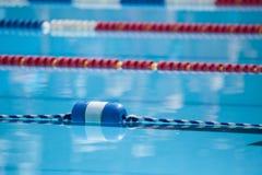Swim Lanes. Bright, colorful swim lanes in an outdoor pool; horizontal image Stock Photos