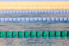 Swim lanes in olympic swimming pool Royalty Free Stock Photo