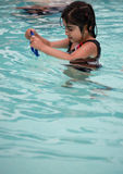 Swim lesson. A 3 year old girl learning how to swim in a swimming class Royalty Free Stock Photography