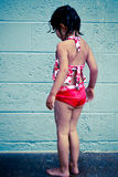 Swim lesson. A 3 year old girl taking a shower after a swim lesson stock photo