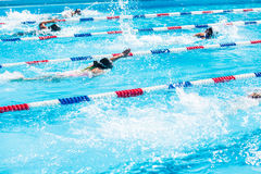 Swim meet. Kids swim meet in outdoor pool during the summer Royalty Free Stock Photography