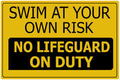 Swim at Own Risk Sign royalty free stock image