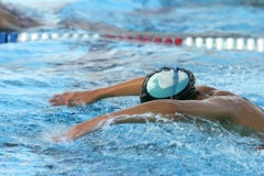 Swim Practice 2. Swimmer practicing butterfly stroke Royalty Free Stock Photos