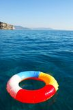 Swim Ring. Floating on beautiful blue water Royalty Free Stock Photo