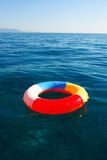 Swim Ring. Floating on beautiful blue water Stock Image