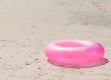 Swim ring on beach Stock Photo