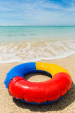 Swim ring at the beach. Travel background with colorful inflatable swim ring at the beach in front of the turquoise sea, Mauritius, Africa Stock Photos