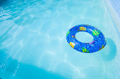 Swim Ring in Pool. A wide angle view of a child's inflatable swim  ring or toy in a swimming pool with copy space Royalty Free Stock Images
