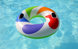 Swim ring in swimming pool. Swim ring floating on a blue swimming pool Royalty Free Stock Photography