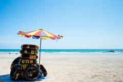 Swim ring with umbrella on the beach Royalty Free Stock Photo