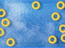 Swim rings on pool Stock Photos