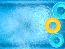 Swim rings on pool Royalty Free Stock Photo